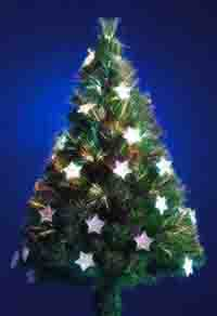 A picture of a Christmas tree decorated in gold and silver
